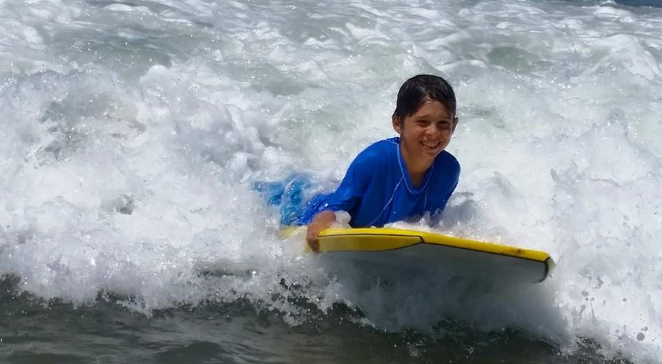 Boy boogie boarding at Fitness by the Sea summer camp