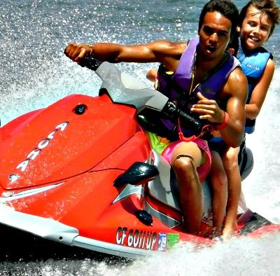 Camp counselor and teenage boy from the Pacific Paliasades jet skiing at Aloha Beach Camp Summer Day Camp.