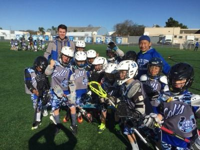 Group photo of coaches and kids in their Lacrosse uniforms and equipment at Culver City Lacrosse Club Summer Camp.