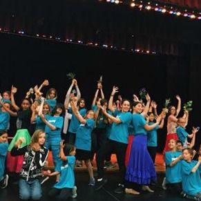 Kids performing on stage at Dee-Ligthful summer camp in Culver City.