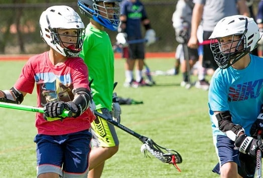 Boys playing lacrosse at Oaks Christian Sports Camp in Thousand Oaks