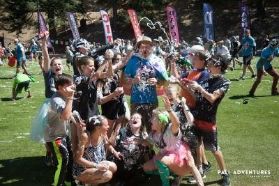 Group of campers and their counselor covered in shaving cream and having fun at Pali Adventures Summer Camp