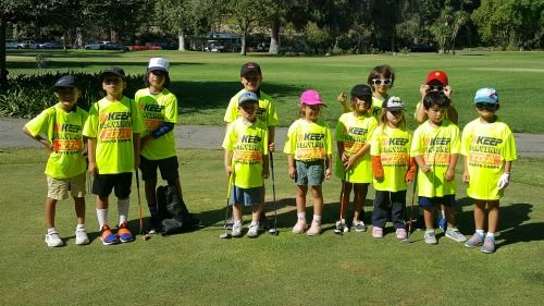 12 campers having fun on the golf course at TGA Premier Sports Camp in Los Angeles