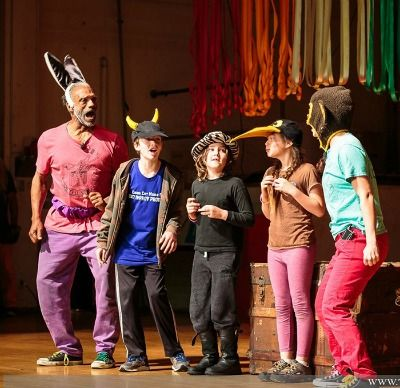 4 kids and their adult acting coach acting in a play at the Actor's Gang summer camp in Culver City.
