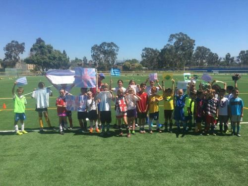 20 campers at UK International Soccer Camps in Los Angeles standing on a soccer field together